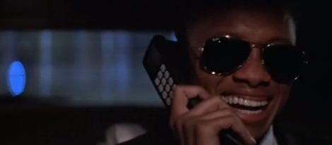 Huge shades. Car phones. Cassette player. Amazing.
