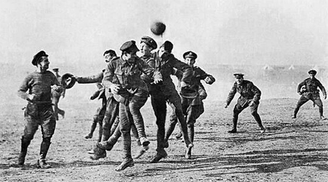 Troops play football in No Man's Land, Christmas Day 1914.